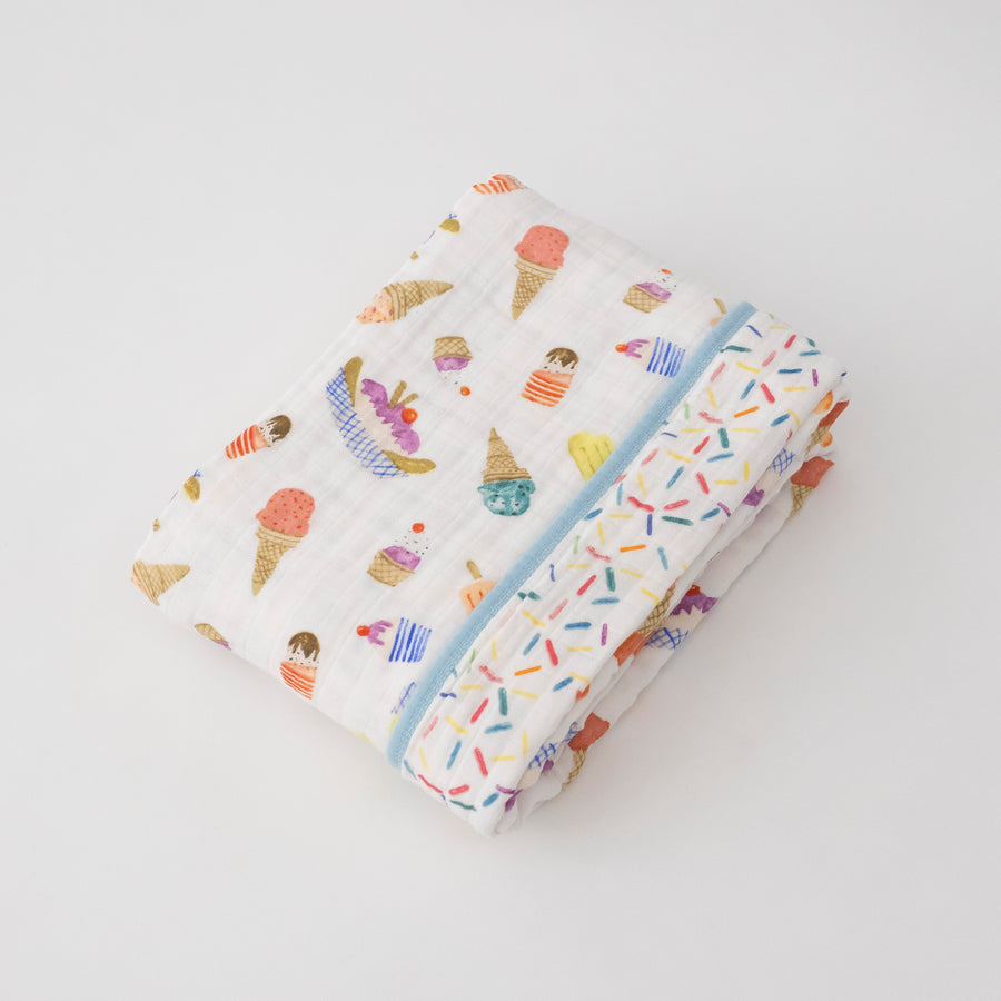 super soft cotton muslin quilt with ice cream cones and other frozen treats on one side and sprinkles on the other side