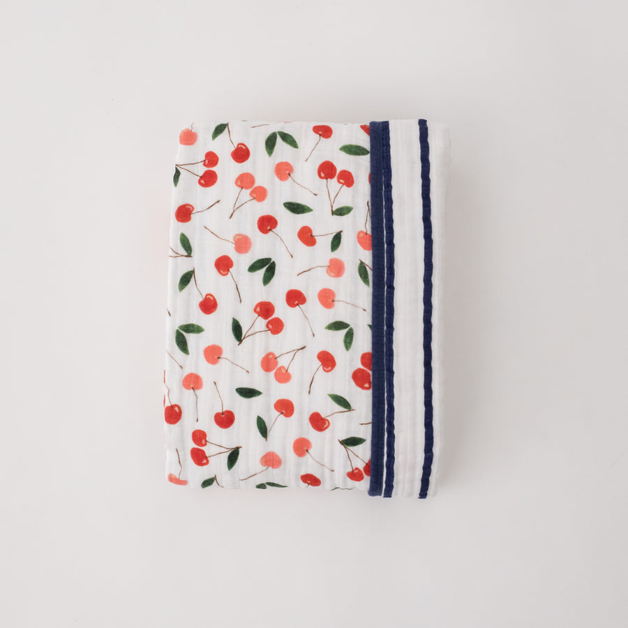 super soft cotton muslin quilt with red and pink cherries on one side and navy and white stripes on the other side