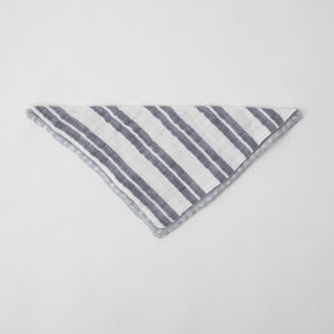 cotton muslin reversible bandana bib with white background and grey double stripe print, side 1