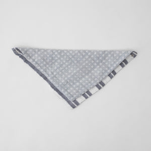 cotton muslin reversible bandana bib with grey background and white x's and o's, side 2