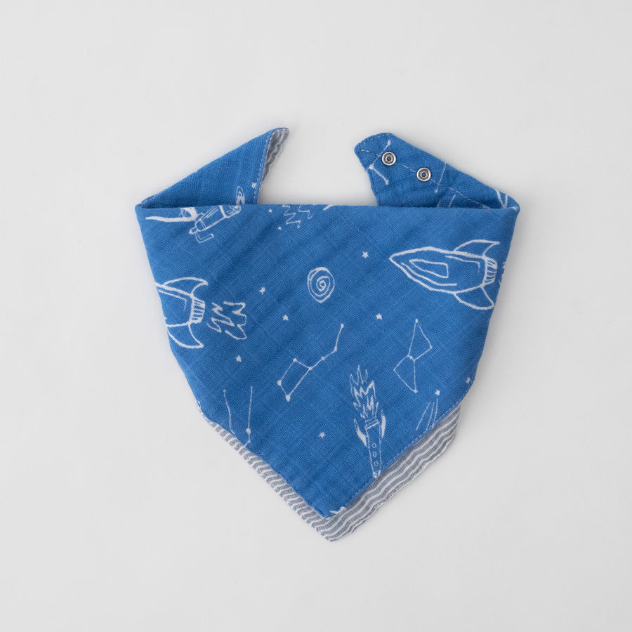 cotton muslin reversible bandana bib with blue background, white stars, rocket ships, and planets. side 1