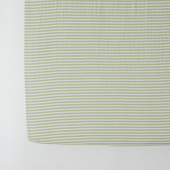 cotton muslin crib sheet with small olive green stripes