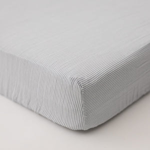 cotton muslin crib sheet with very small grey stripes