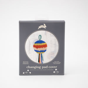 cotton muslin changing pad cover with party them print including pinatas, confetti, cake, balloons, party hats and more in Red Rover packaging