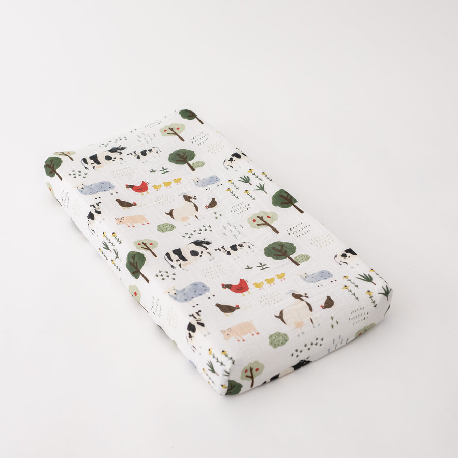 cotton muslin changing pad cover with farm animals including cows, chickens, goats, sheep, and pigs