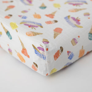 cotton muslin changing pad cover with ice cream cones, banana splits, popsicles, and other frozen treats