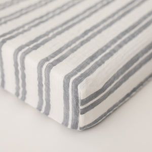 cotton muslin changing pad cover with grey double stripes on a white background