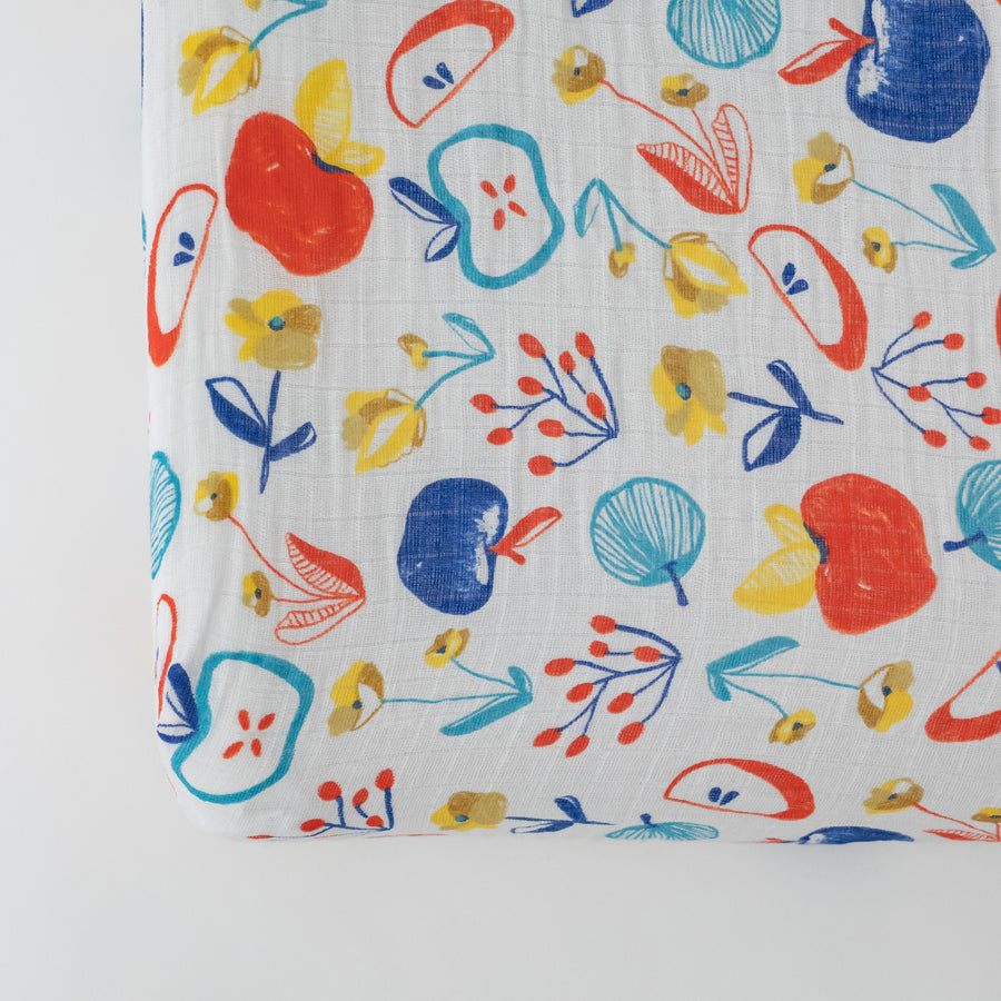 cotton muslin changing pad cover, with colorful whole and sliced apples