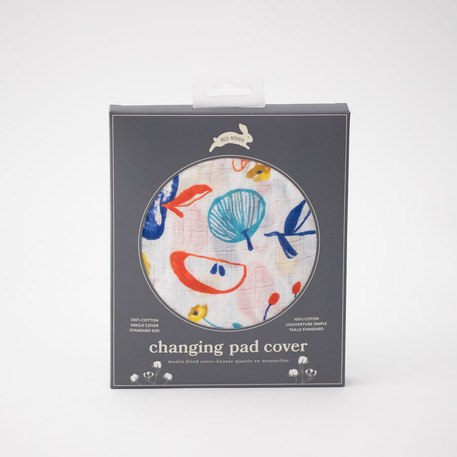 cotton muslin changing pad cover, with colorful whole and sliced apples, in Red Rover packaging