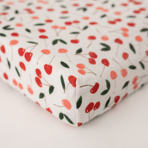 cotton muslin changing pad cover, with red and pink cherries and green leafs