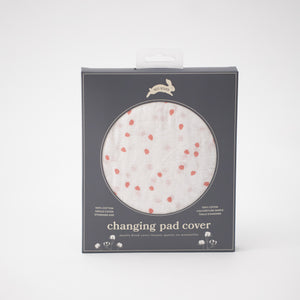 cotton muslin changing pad cover with pink cherry blossom petals on a white background in Red Rover packaging