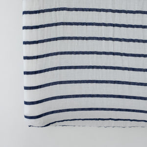 cotton muslin changing pad cover with navy stripes on a white background