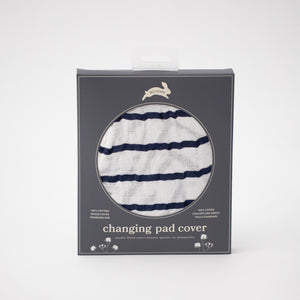 cotton muslin changing pad cover with navy stripes on a white background in Red Rover packaging