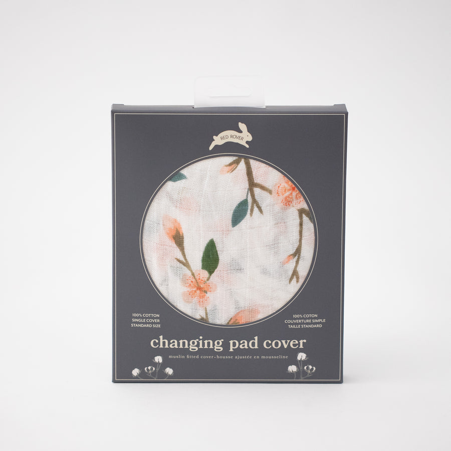 cotton muslin changing pad cover with pink peach blossoms blooming on a branch with leaves in Red Rover packaging