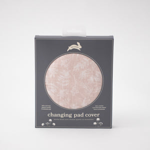 cotton muslin changing pad cover with small white flowers on a blush background in Red Rover packaging