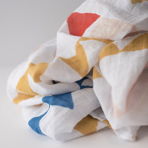 single swaddle blanket with yellow red and blue triangle banners