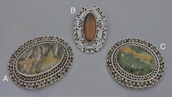 Silver gemstone brooches