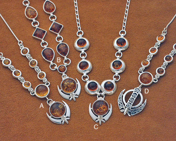 Silver and amber adi shakti necklaces