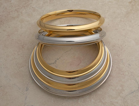 Medium heavyweight solid stainless steel Karas - some with gold tone