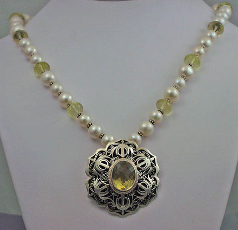 Silver pearl necklace with citrine adi shakti pendant