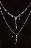 Small diamond encrusted dagger necklaces