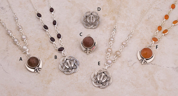 Flower of Life Adi Shakti pin pendants and pendants on gemstone and pearl necklaces and multi-faceted gemstone Adi Shakti pendants - on these same necklaces