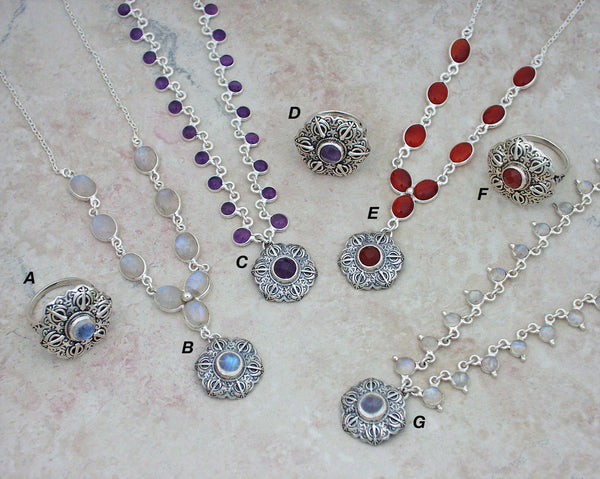 Gemstone necklaces with Adi Shakti Talisman pendants and matching rings
