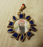 Reversible gold pendant with portrait of Guru Ram Das and gemstones