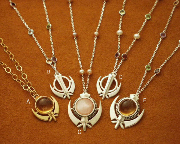 Gemstone and pearl necklaces with varied Adi Shakti pendants