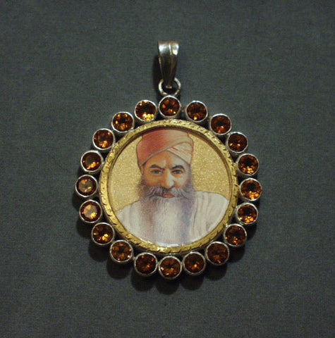Portrait of Yogi Bhajan in silver and citrine