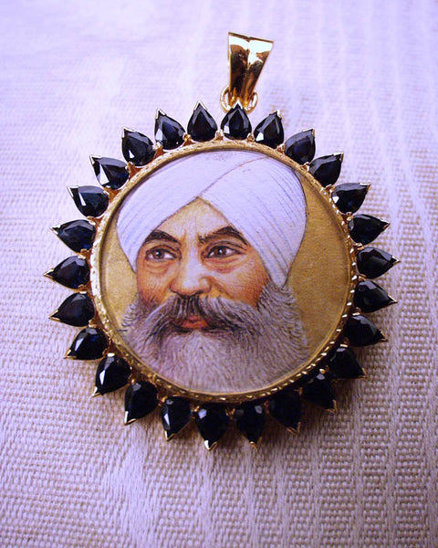 Portrait of Yogi Bhajan in gold with sapphires