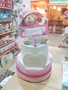 two tier nappy cakes, newborn gifts, baby gifts, personalised gifts, nappy cakes, babyshower gifts, ideas, flower gifts, new parent gifts, baby shower gift idea, maternity gifts, corporate gifts, london, christmas gifts, wooden plaque, feeding bottle, teddy bear, nursery rhymes, gifts for baby girl