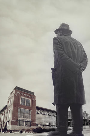 Vince Lombardi looks in the midst of Lambeau Field