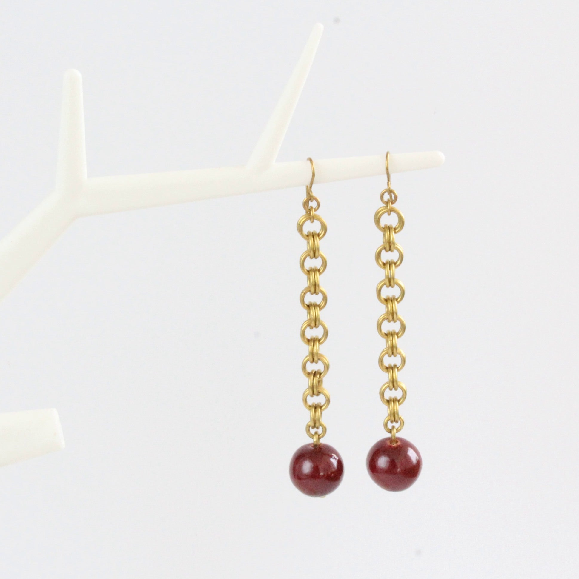 African handmade brass earrings with burgundy clay bead