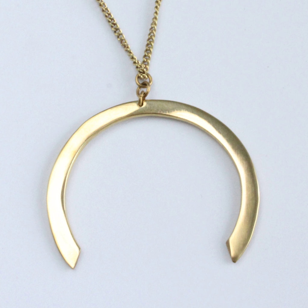 Handmade African brass horseshoe shaped necklace