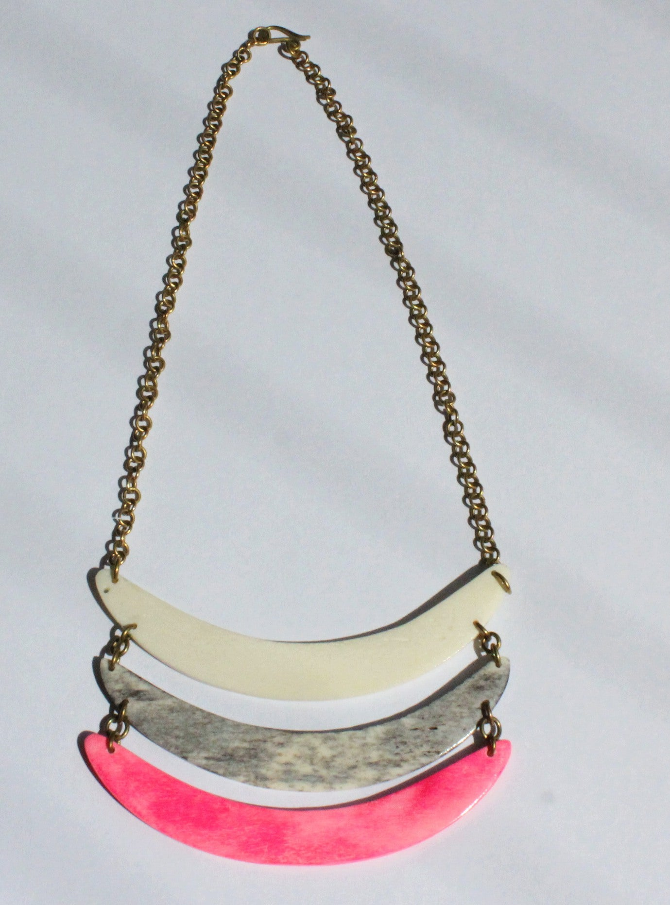 Brass necklace with recycled bone pink grey white