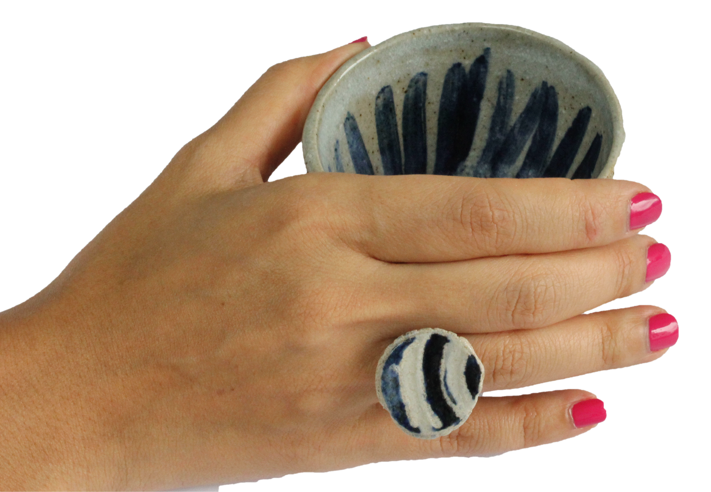 Japanese pottery tea cup and ring on hand