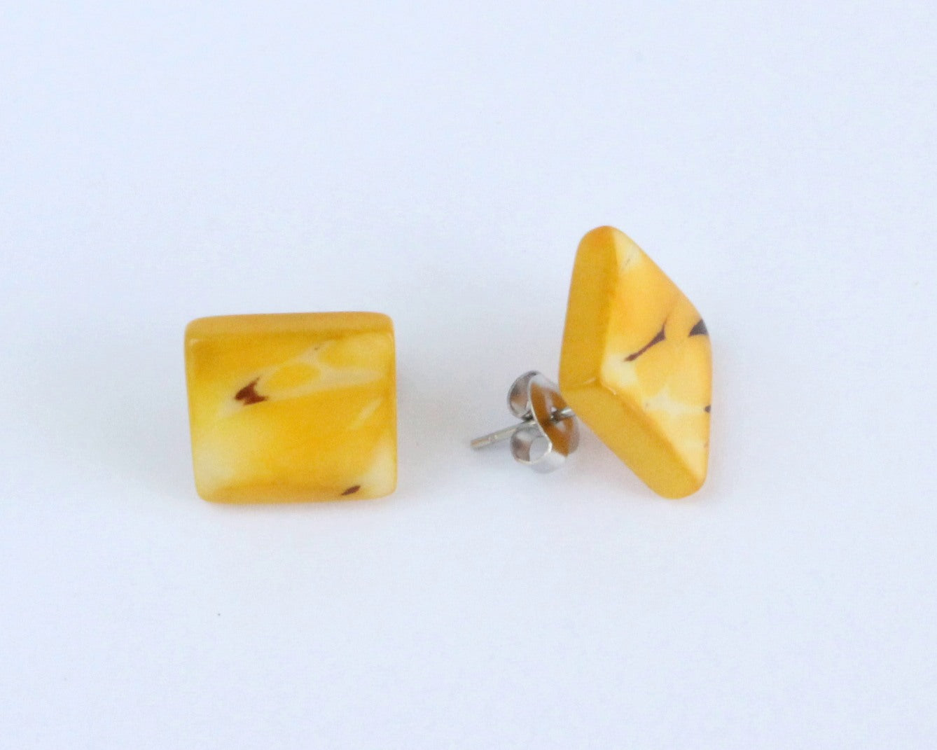 Handmade earring, sustainable, tagua, stud, push back, yellow, side