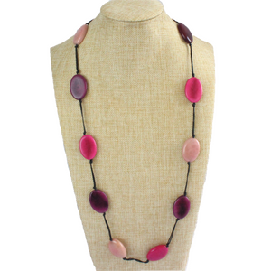 Necklace, sustainable tagua nut, pink, adjustable, handmade, stand