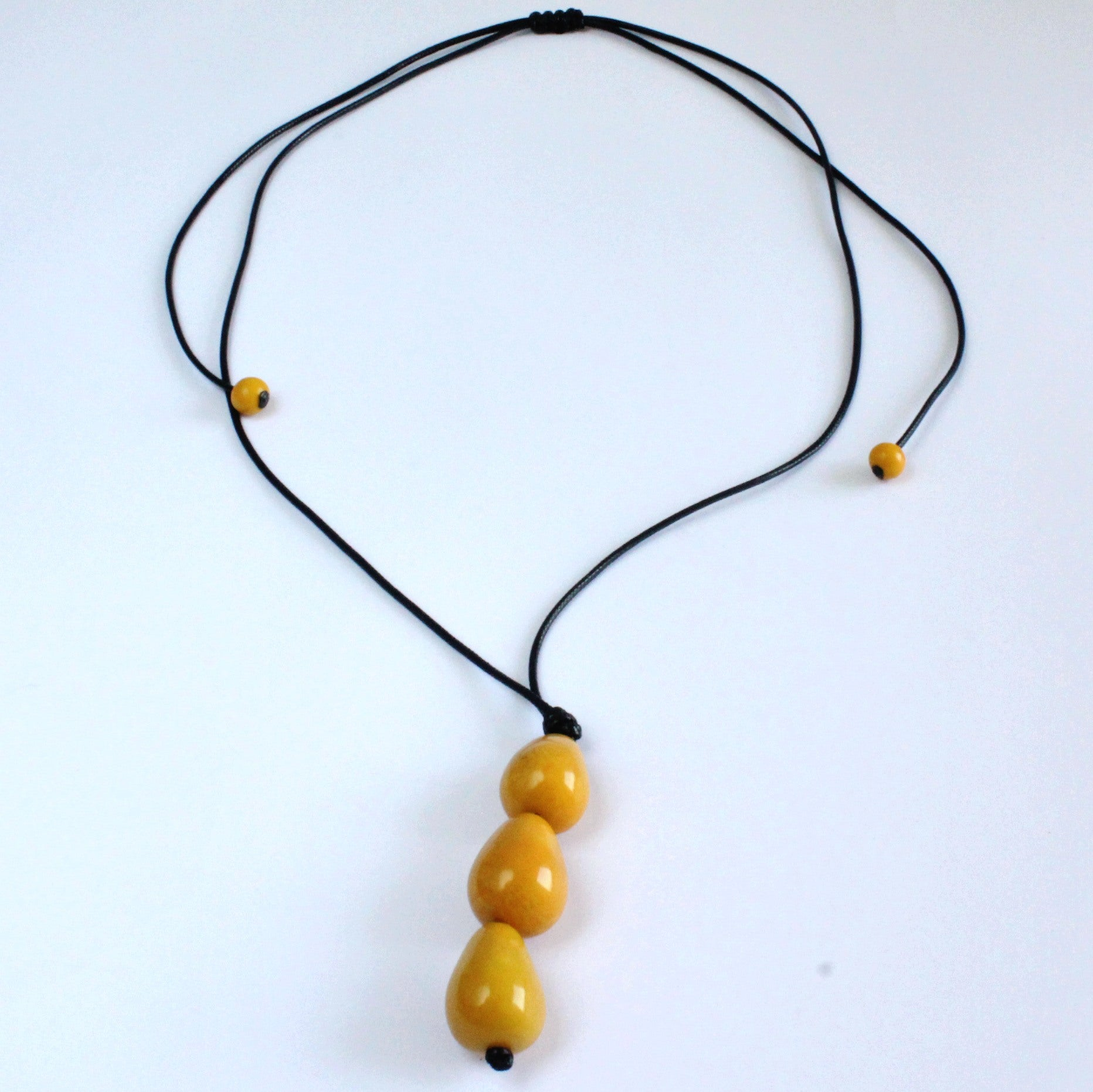 Necklace, handmade, sustainable tagua nut, mustard