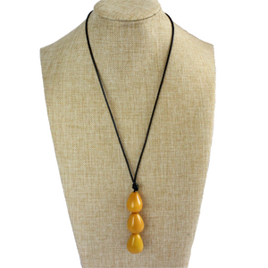 Necklace, handmade, sustainable tagua nut, mustard, stand