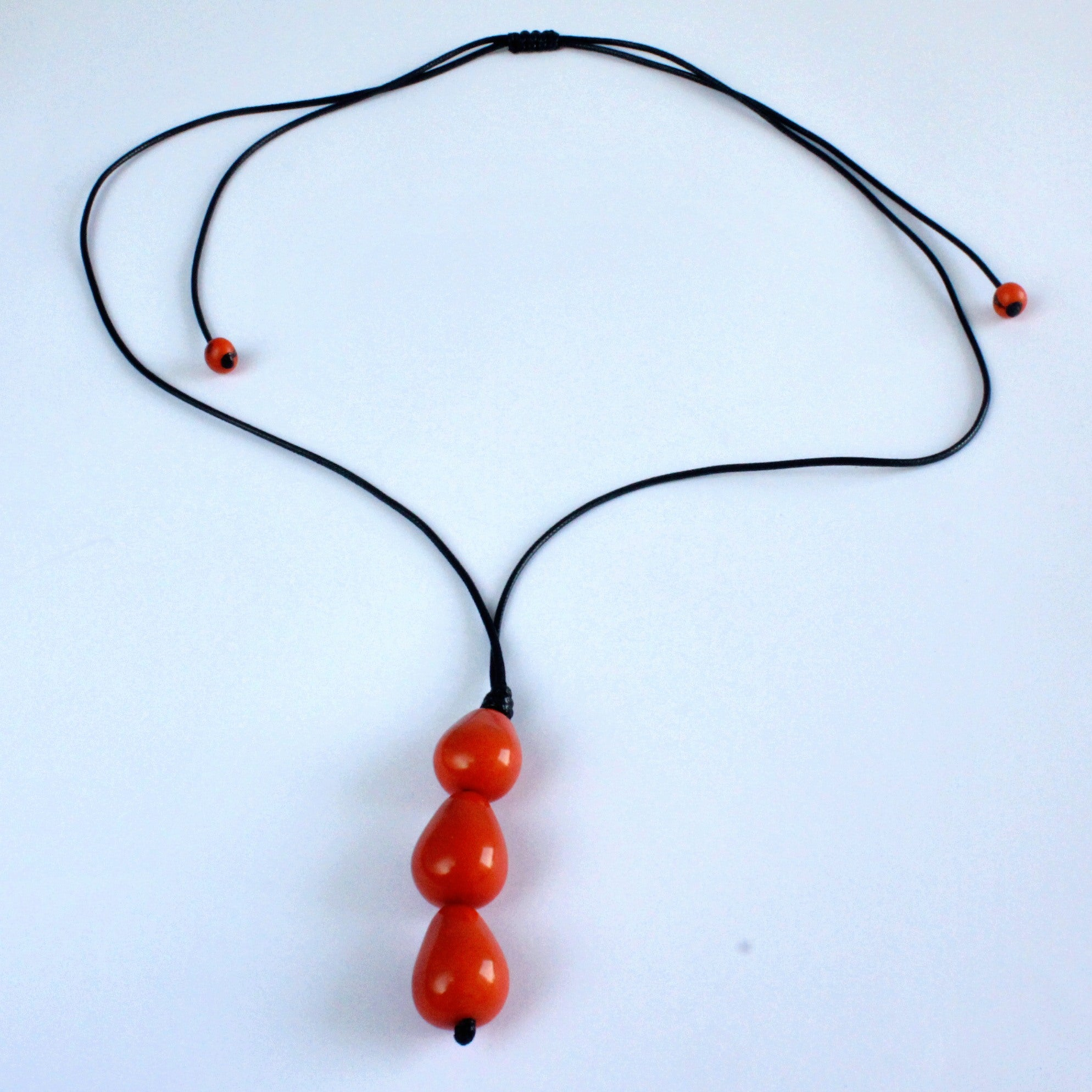 Necklace, handmade, sustainable tagua nut, orange