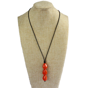 Necklace, handmade, sustainable tagua nut, orange, stand