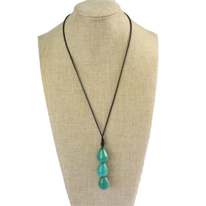 Necklace, handmade, sustainable tagua nut, turquoise, stand