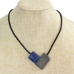Handmade necklace, sustainable, tagua nut, magnetic lock, blue grey, stand