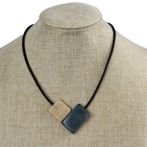 Handmade necklace, sustainable, tagua nut, magnetic lock, grey beige, stand