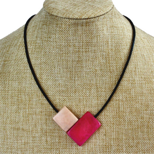 Handmade necklace, sustainable, tagua nut, magnetic lock, pink, stand