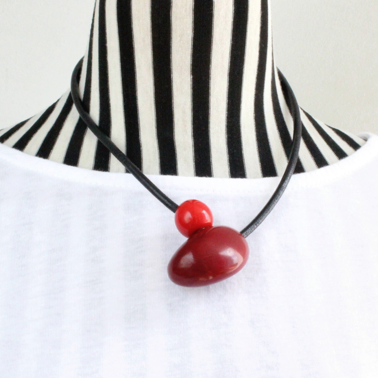 Handmade necklace, tagua nut, sustainable, magnet, burgundy, stand