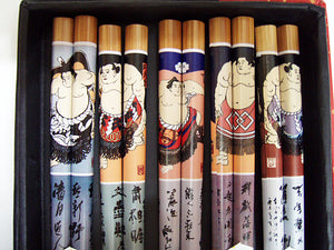 Sumo image chopsticks in box.