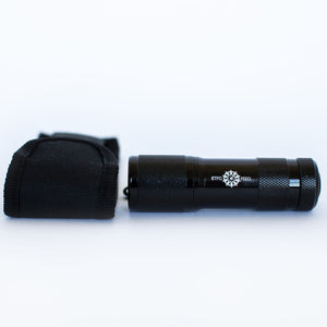 An Mini Flash Light with the ETFO logo.